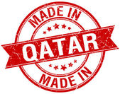 Made in Qatar red round vintage stamp — Cтоковый вектор