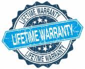 Lifetime warranty blue round grunge stamp on white — Stock Vector