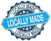 Fabriqués localement timbre grunge rond bleu sur blanc — Vecteur