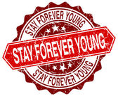 Stay forever young red round grunge stamp on white — Stock Vector