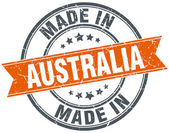 Australia orange grunge ribbon stamp on white — Stock Vector