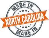 North Carolina oranje grunge lint stempel op wit — Stockvector