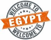 リボン スタンプをラウンド エジプト オレンジへようこそ — ストックベクタ