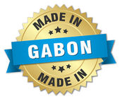 Made in Gabon gold badge with blue ribbon — Stock Vector