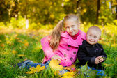 Children  sitting in the grass — Stock Photo