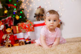 Girl near Christmas tree. — Stock Photo