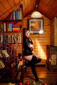Beautiful girl in winter house — Stock Photo