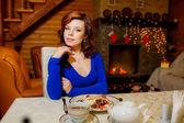 Beautiful girl at holiday table — Stock Photo