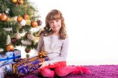 Adorable girl near Christmas tree — Zdjęcie stockowe