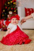 Little girl near the Christmas tree at home — Stock Photo