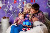 Family at home near the Christmas tree. — Stock Photo