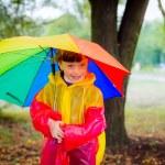 Girl under multicolored umbrella — Stock Photo #53998189