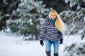 Blonde girl in a snowy forest. — Stock Photo