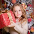Little girl near the Christmas tree. — Stock Photo #54265391