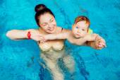 Mother with a child in the pool. — Stock Photo