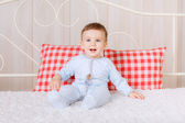 Boy  in pajamas on the bed — Stock Photo
