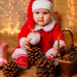 Beautiful little girl in a New Year's suit — Stock Photo #55365945