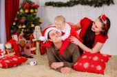 Happy family near the Christmas tree. — Stock Photo