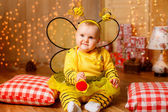 Little girl in a bee suit — Stock Photo