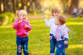 Kids with soap bubbles — Stock Photo