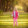 Little girl jumping in  park — Stock Photo #56606619