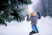 Beautiful young blond woman jumping — Stock Photo