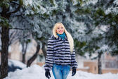 Beautiful blond woman in winter park — Stock Photo