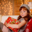Happy little girl holding gift — Stock Photo #57297787