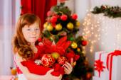 Adorable girl near Christmas tree — Stock Photo