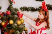 Girl near the Christmas tree. — Stock Photo