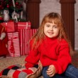 Little girl with New Year presents — Stock Photo #58901657