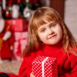 Little girl with New Year presents — Stock Photo #58901725