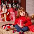 Little girl with New Year presents — Stock Photo #58901755