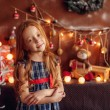Girl in the New Year decorated room — Stock Photo #59069599