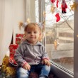 Girl with gifts on a windowsill — Stock fotografie #59862233