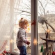 Girl with gifts on a windowsill — Foto de Stock   #59862333