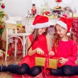 Two happy girls in Christmas hats — Stock Photo #60934577