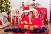 Two happy girls in Christmas hats — Stock Photo
