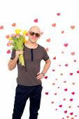 Stylish guy with a bouquet of flowers — Stock Photo