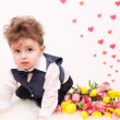 Curly-haired boy with a bouquet of tulips. — Stock Photo #64393931