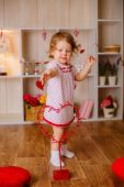 Little girl playing with a heart — Stock Photo