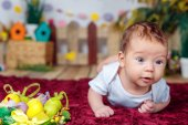 Baby with Easter decorations — Stock Photo