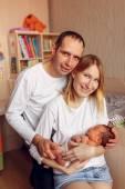 Happy family with  newborn baby — Stock Photo