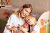 Mother, daughter and newborn son — Stock Photo