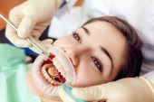 Dental treatment on a female patient — Stock Photo