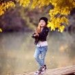Little girl  in the autumn park — Stock Photo #69555239