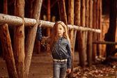 Little girl posing near wooden battens — Stock Photo