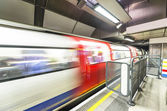 London tube arriving in a station — Stock Photo