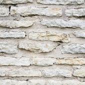 Old limestone brick wall fragment — Foto Stock