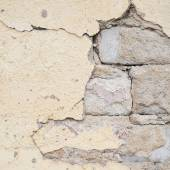 Brick wall with the whitewash falling off — Foto Stock